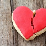 Cracked cookie as a concept of broken heart